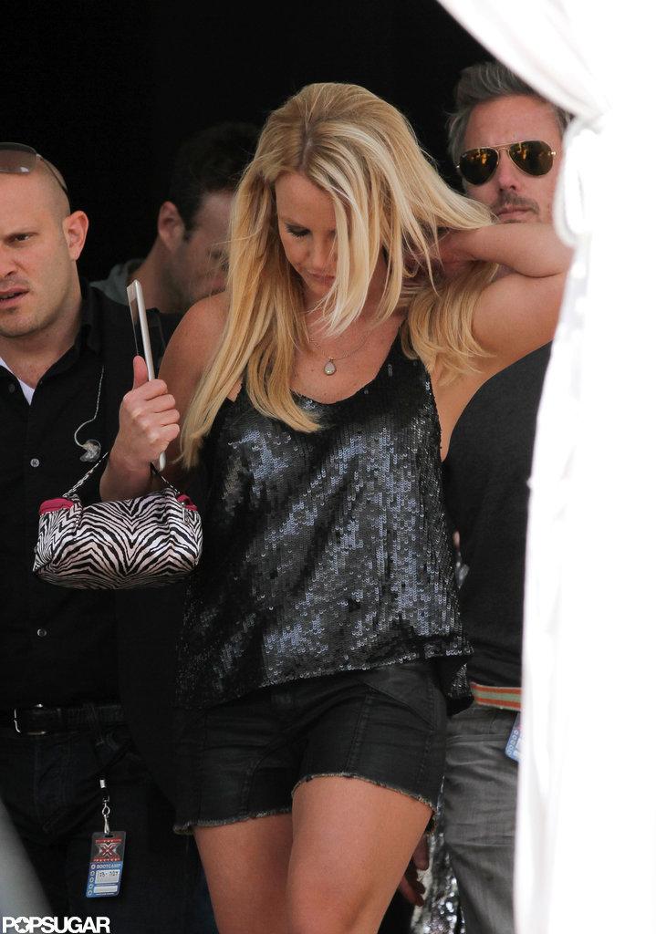 Jason Trawick walked behind Britney Spears.