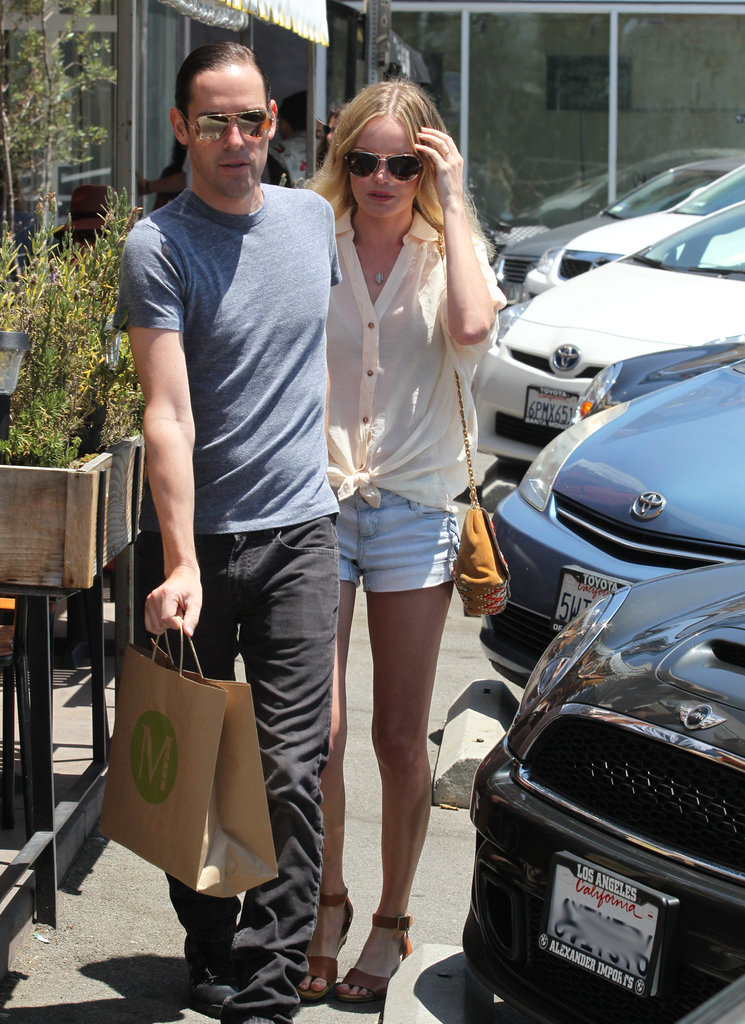 Kate Bosworth and Michael Polish held hands while heading back to their car.