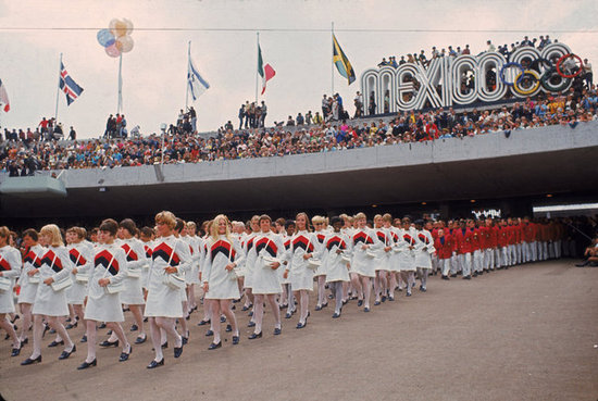 For the 1968 Summer games in Mexico City, the women marched in the opening ceremony in matching white uniforms, all laden with a red-and-blue V stripe along the chest. Although it may have been warm outside, the ladies donned sheer tights and black loafers, too.