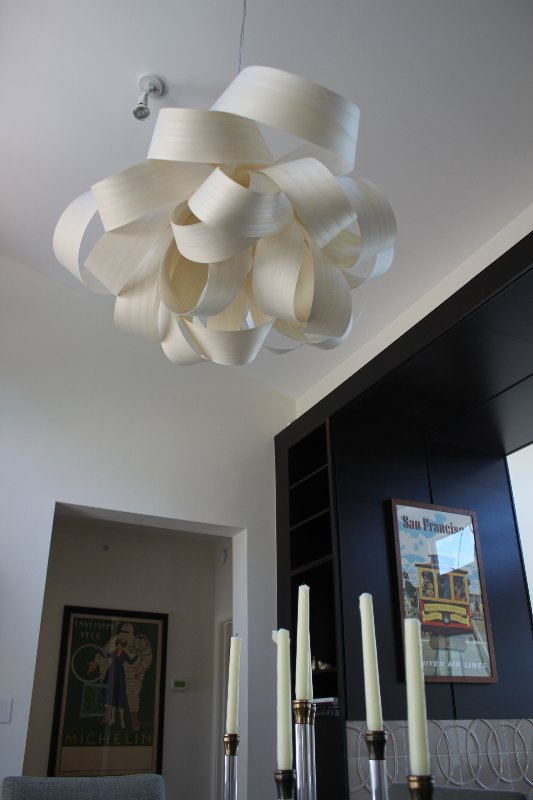 The Agatha Suspension Lighting adds modern sculptural appeal to the dining space.