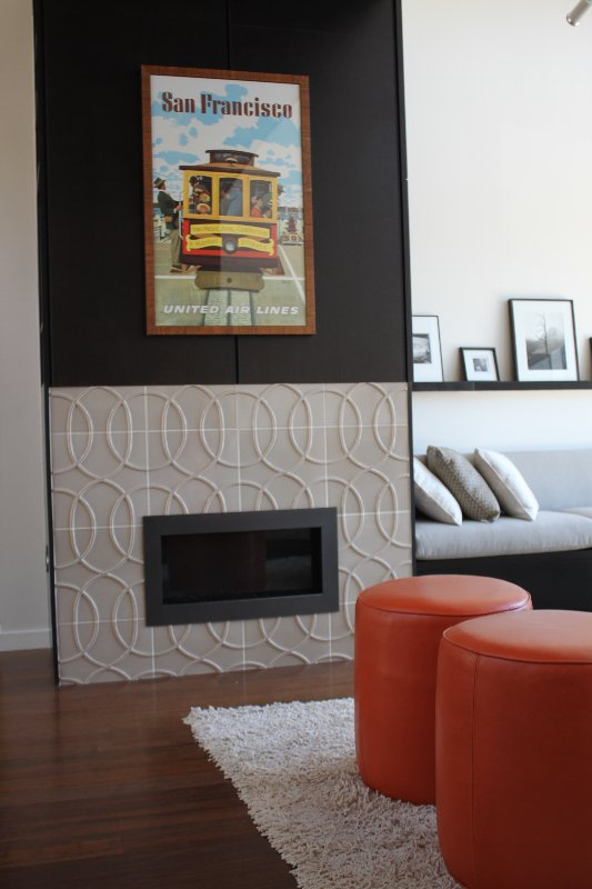 Immediately to the right of the fireplace is a built-in seating area.