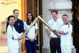 The Duke and Duchess of Cambridge, as well as Prince Harry, watched the torch pass off at Buckingham Palace the day before the London Games start.