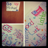 Michael Phelps couldn't make it to the opening ceremonies; however, he did share a picture of the good luck signs decorating Team USA's housing. Source: Twitter User michaelphelps