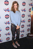Lindsey Wixson mixed and matched a pastel knit and brogues with floral-print jeans at a screening for The Campaign.