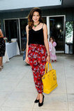 Michelle Monaghan outfitted a chic play on print with a solid black tank against her high-waisted floral pants. A canary yellow bag played perfectly off of her red trousers.