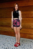 Jena Malone tried out the crop top trend, paired with high-waisted, floral-print shorts, and a pair of red heels to sweeten the style.