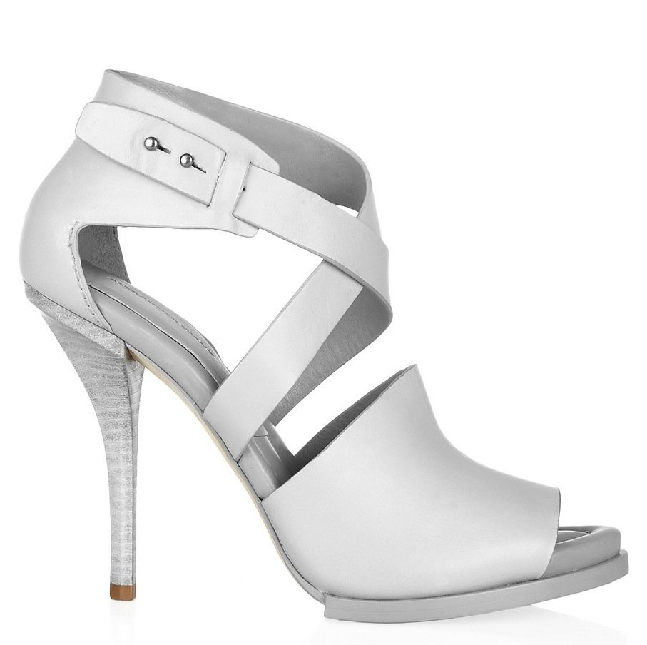 True to his preceding structural shoe masterpieces, Alexander Wang has made the slickest white leather sandal we've seen in awhile. Yes, this gives us even more reason to wear white after Labor Day. Alexander Wang Leather Sandals ($495)