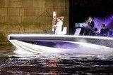 David Beckham drove a speedboat with the Olympic torch on board.