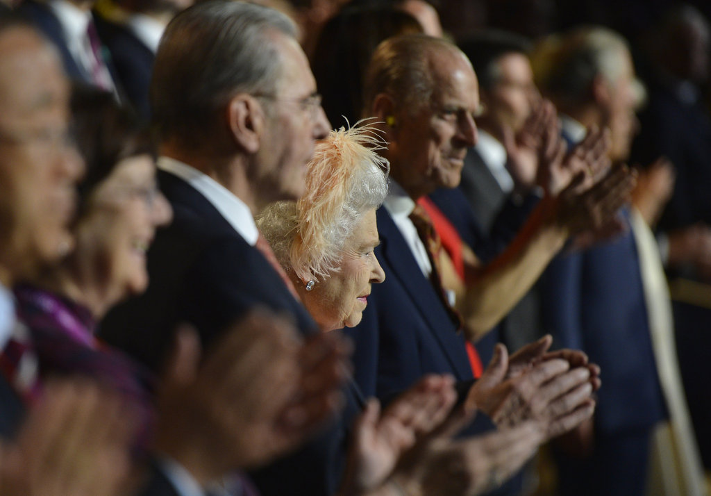 The queen clapped beside her husband.