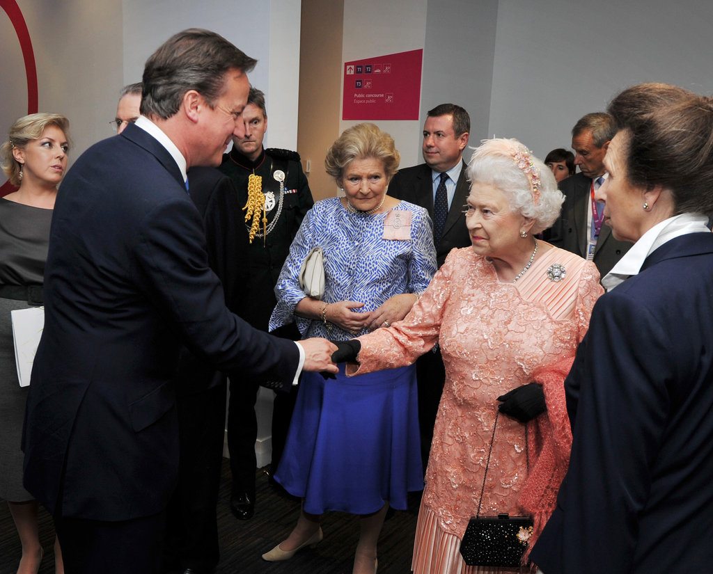 Queen Elizabeth shook hands with Prime Minister David Cameron.
