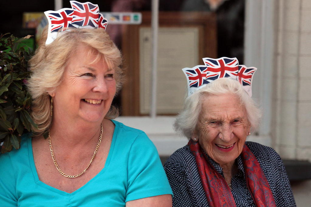 Two women waited for the torch to pass in Minehead, England.