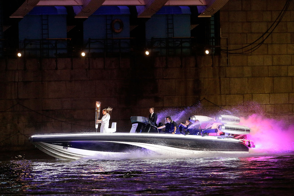 David Beckham made a splash by driving a speedboat carrying the torch.
