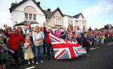 Crowds cheered along the torch relay route in Poole, England.