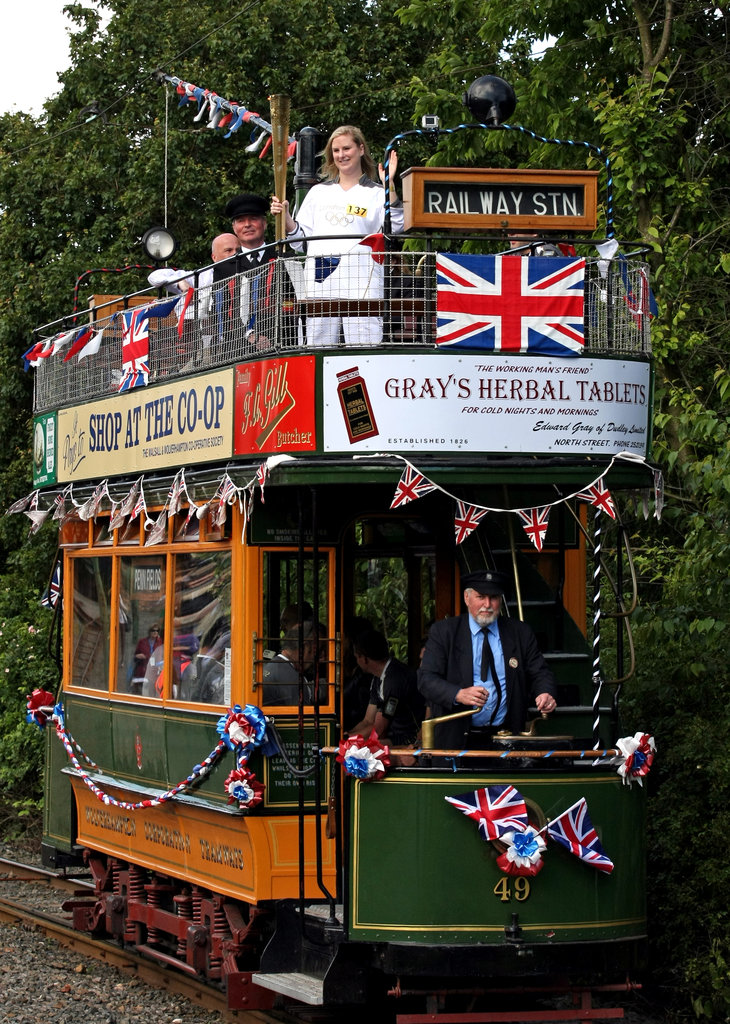 Kate Macfarlane carried the Olympic torch on the Black Country Living Museum tram in Dudley, England.