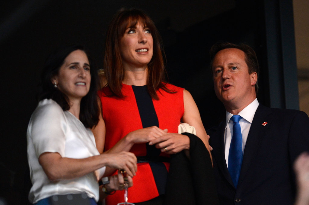 British Prime Minister David Cameron and his wife, Samantha, chatted with Marina Johnson, wife of London Mayor Boris Johnson, ahead of the opening ceremony.