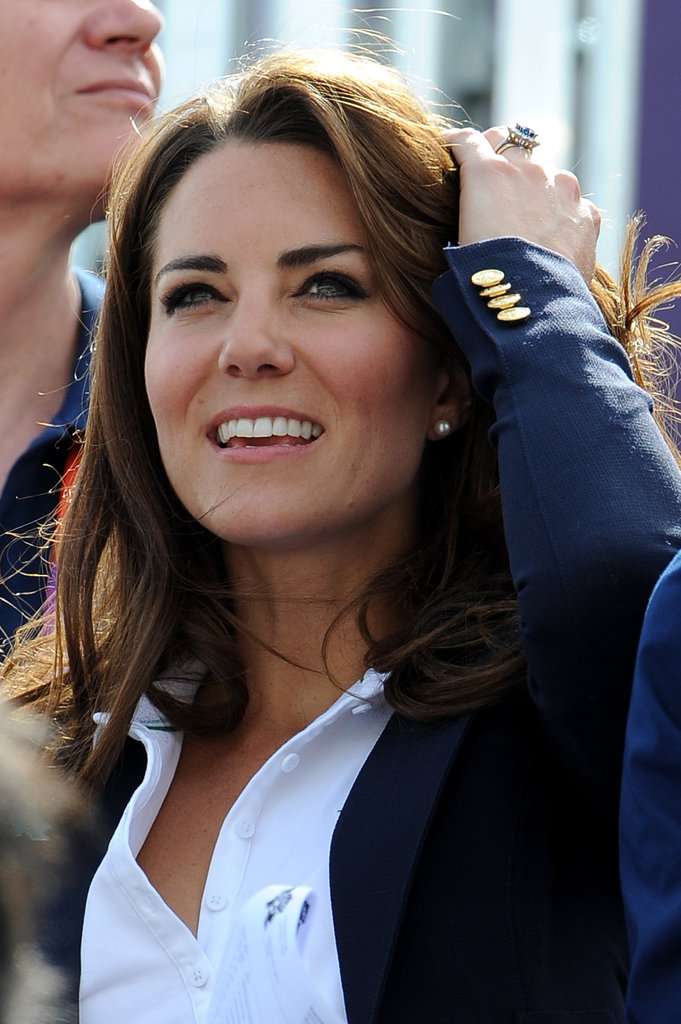 Kate fixed her hair while cheering on Team GB.