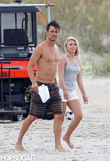 Josh Duhamel carried a script on the beach.