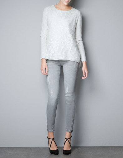 A lacy iteration has that special feminine finish to give even boyfriend jeans a girlier counterpoint.  Zara Knitwear With Lace Front ($80)