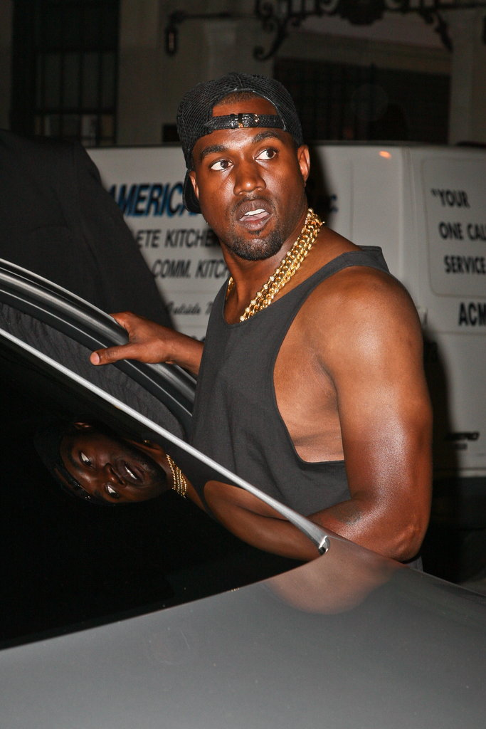Kanye West beat the East Coast heat in a black tank top.