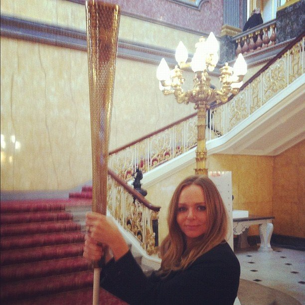 Stella McCartney held onto an Olympic torch at the British embassy.  Source: Instagram user stella_mccartney