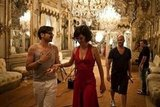 Penélope Cruz wore a low-cut red gown on the set of the Campari calendar shoot. Source: Facebook user Campari
