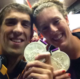 US swimmers Michael Phelps and Allison Schmitt showed off their medals on the bus back to the Olympic village.  Source: Twitter user arschmitty