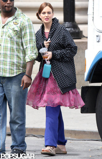 Leighton Meester covered up in a sweatshirt on the set of Gossip Girl.