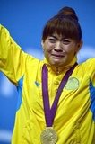 Kazakhstan's Maiya Maneza cried on the podium after reciving her gold medal for weightlifting.