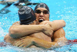 US swimmers Matt Grevers and Nick Thoman hugged after winning gold and silver, respectively, in the final of the men's 100m backstroke.