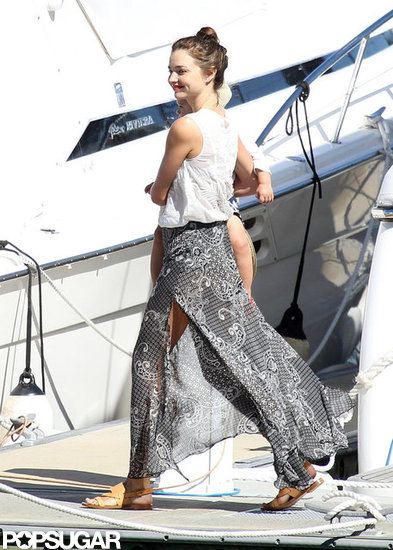 Miranda Kerr carried Flynn onto a yacht.