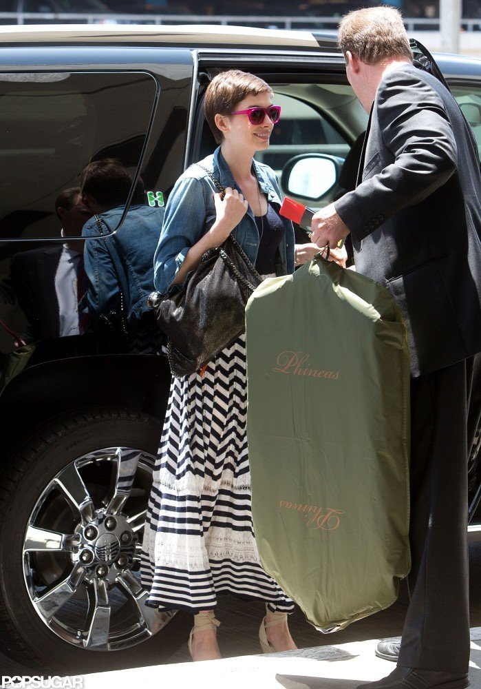 Anne Hathaway got out of her SUV at LAX.
