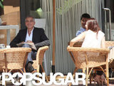 George Clooney sat with extras.