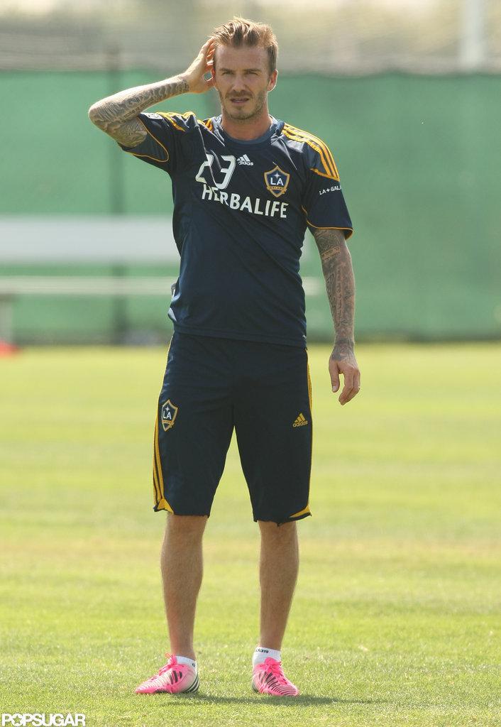 David Beckham combed his hair back at soccer practice.