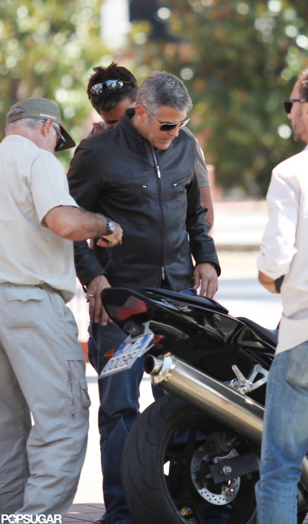 George Clooney wore a leather jacket.