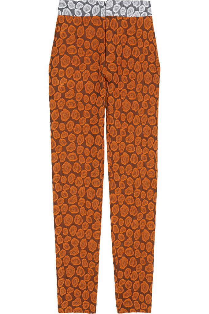 Inject an unexpected contrast with white ankle-strap sandals. Michael van de Ham Leopard Brocade Tapered Pants ($450)