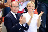 The Prince and Princess of Monaco clapped for the swimmers.