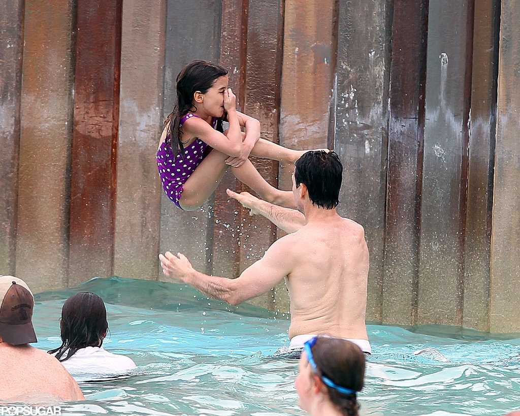 Suri Cruise caught some air at the water park with Tom Cruise.