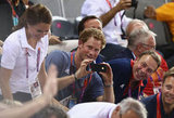 Prince Harry snapped pictures of the Olympics.