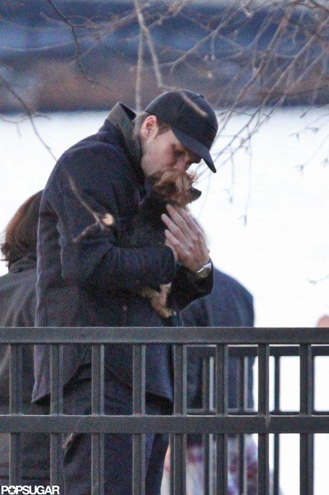 Tom Brady kissed Gisele Bundchen's pup, Vida, during a November 2011 stroll around Boston.