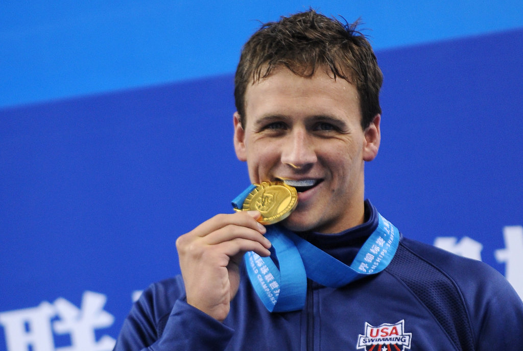 Ryan bit the gold medal he won for the men's 200-meter freestyle final at the FINA World Championships in Shanghai in 2011.