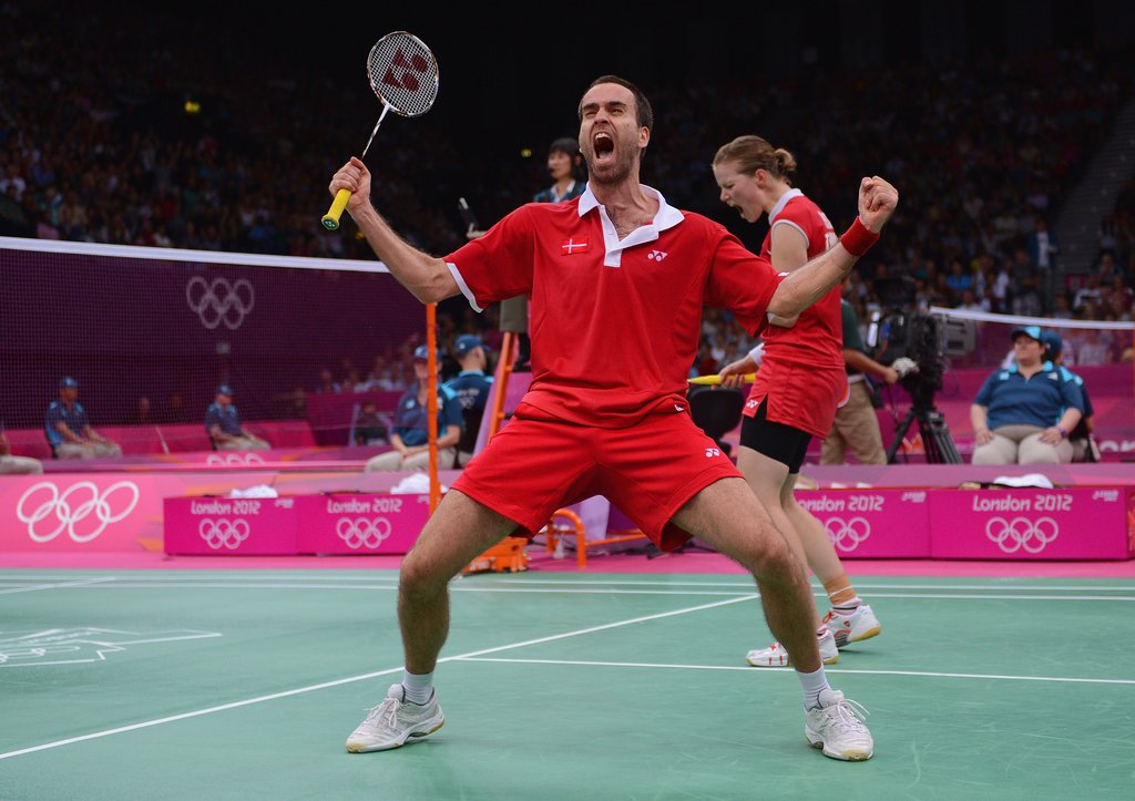 Joachim Fischer Nielsen of Denmark couldn't contain his excitement after winning in mixed doubles badminton.