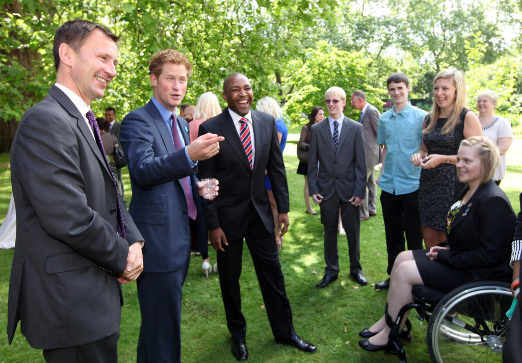Prince Harry was joined by Culture Secretary Jeremy Hunt and Olympic gold medalist Darren Campbell at a reception for young athletes on day six of the London Games.