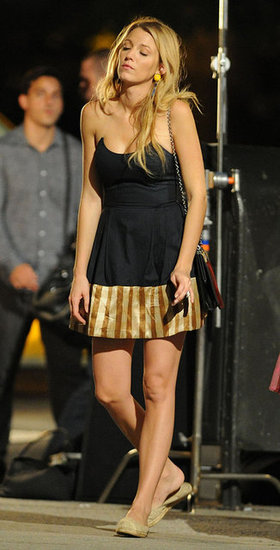 Blake Lively slipped into more comfortable shoes between takes.