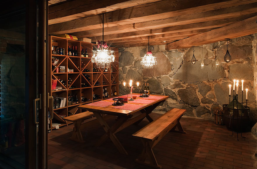 Enjoy a bottle of wine with friends in the home's wine cellar.