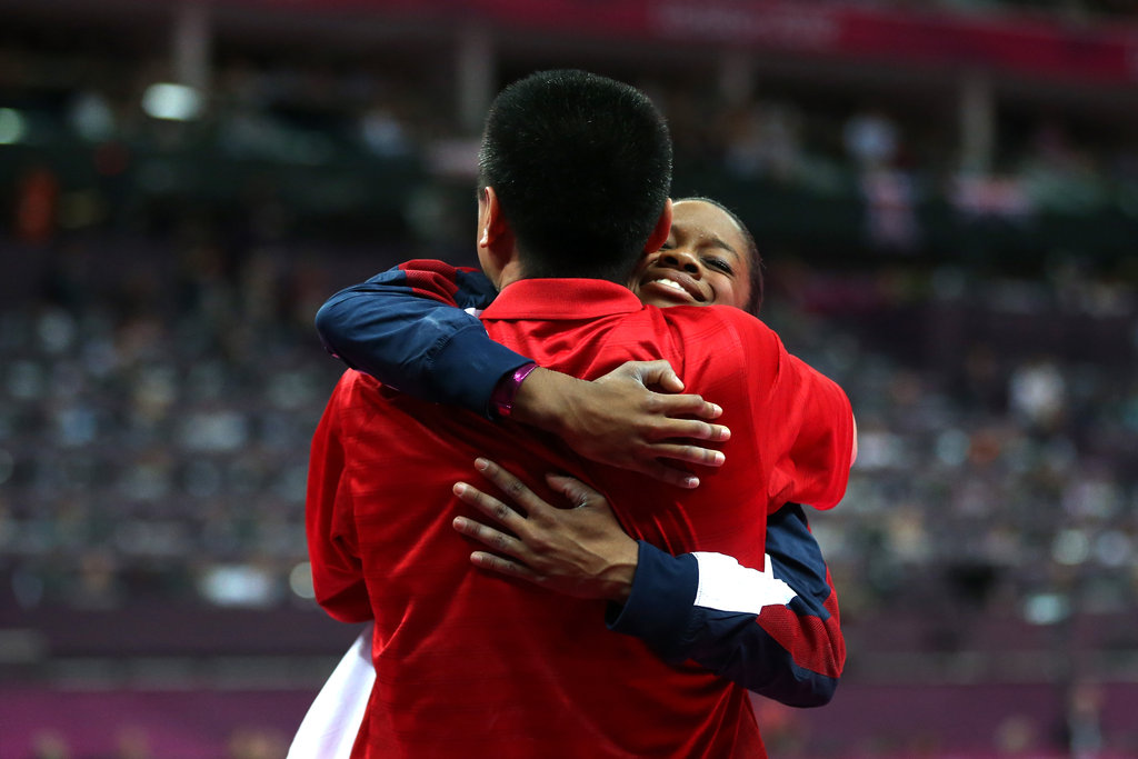 An emotional Gabby Douglas hugged her coach Liang Chow after winning gold in the all-around.