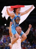 A happy Saori Yoshida of Japan held a flag after winning gold in her wrestling match.