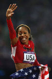 Runner Sanya Richards-Ross of the United States waved to the crowds after winning gold.