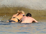 Paris Hilton and her mystery man spent time in the water on Cavallo Island.