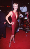 Charlize Theron hit the October 1997 premiere of Devil's Advocate in a bandage-style red dress.