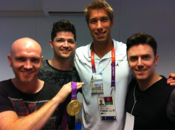 Matt Grevers posed with the band, The Script.  Source: Twitter user MattGrevers